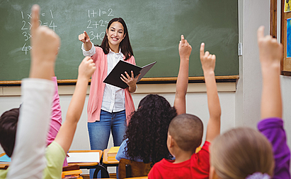 Photo of Classroom Raising Hands